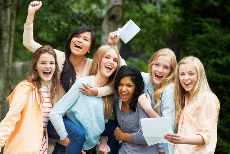 University students celebrating excellent results