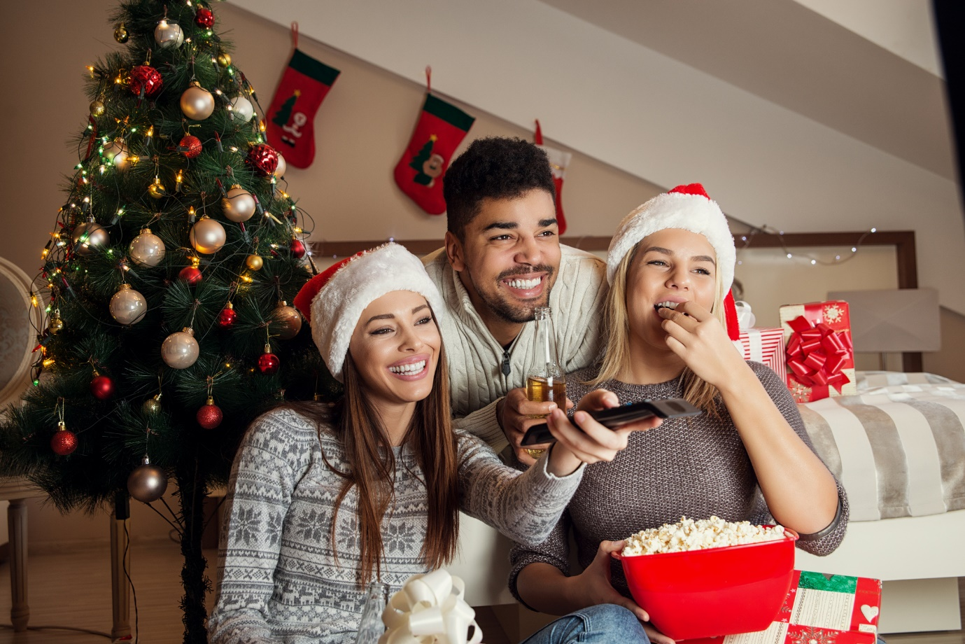 flatmates watching tv on christmas