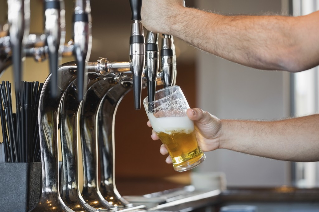 Barman Pulling A Pint of Beer - iStock_000044003752_Double
