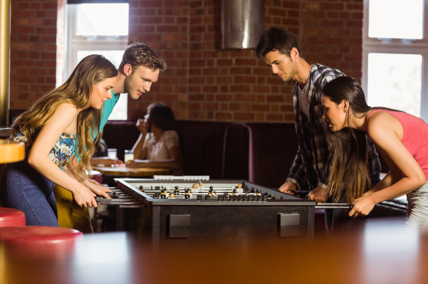 Students playing table football iStock_000056059590_Small