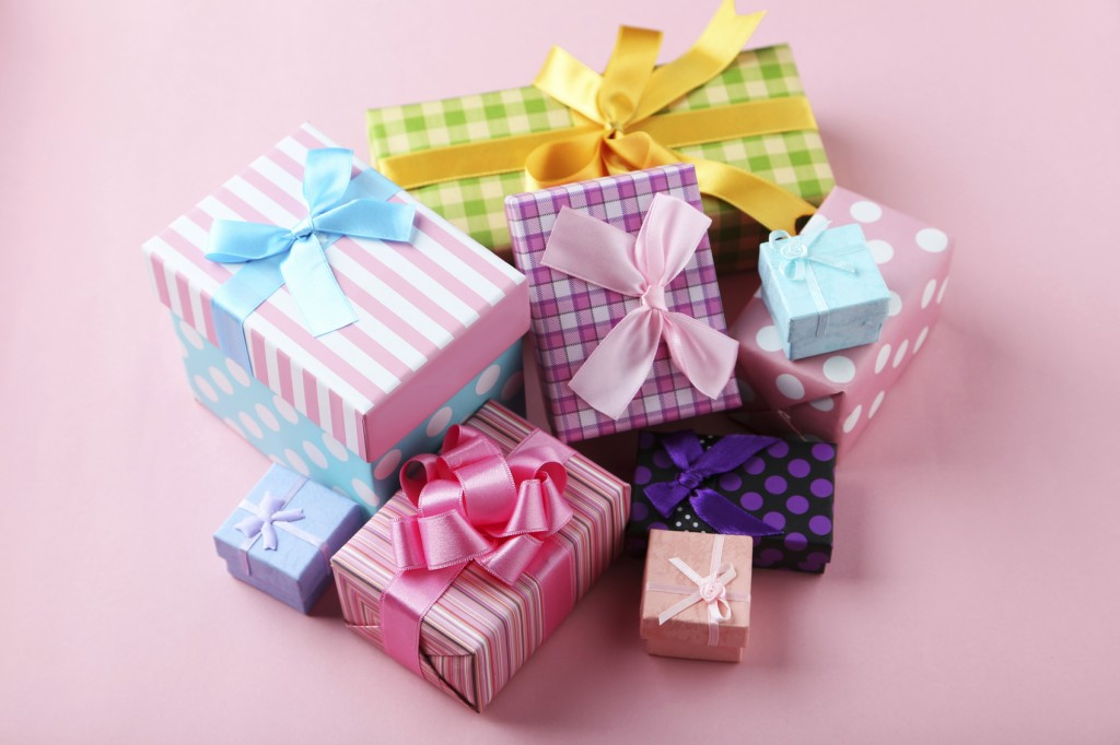 Beautiful gift boxes on pink background