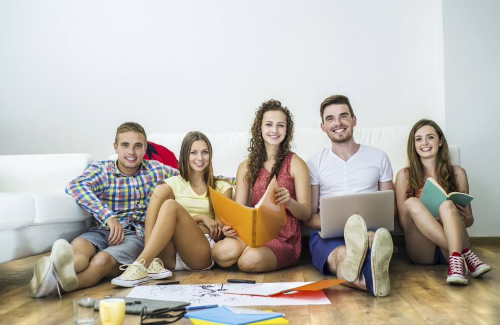 Group Of Young Students Studying - iStock_000050017676_Medium