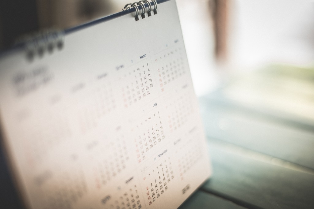 Blurred calendar page blue background.