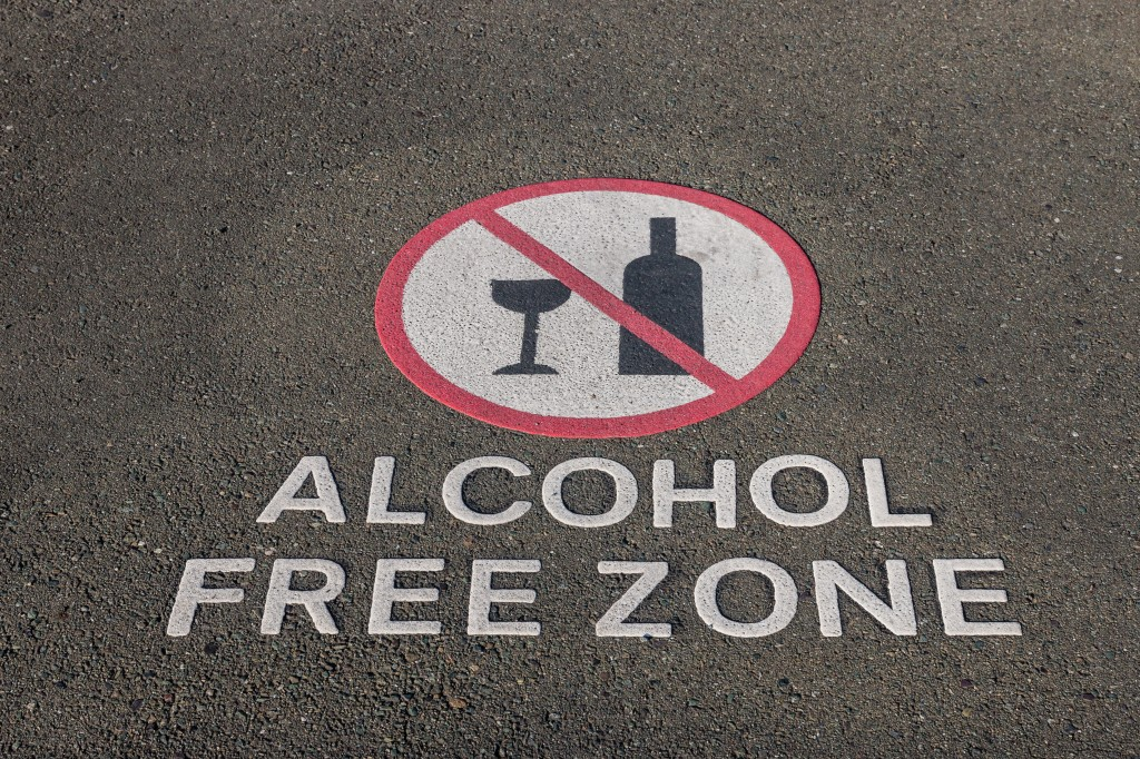 alcohol free zone sign on pavement