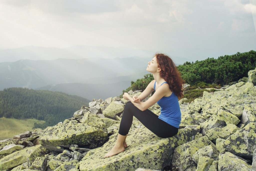 Woman feel freedom and enjoy the beautiful view in the mountains